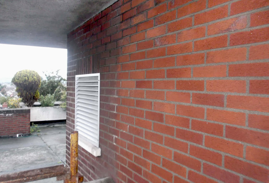 Cleaning red brick with chemicals to remove carbon deposits