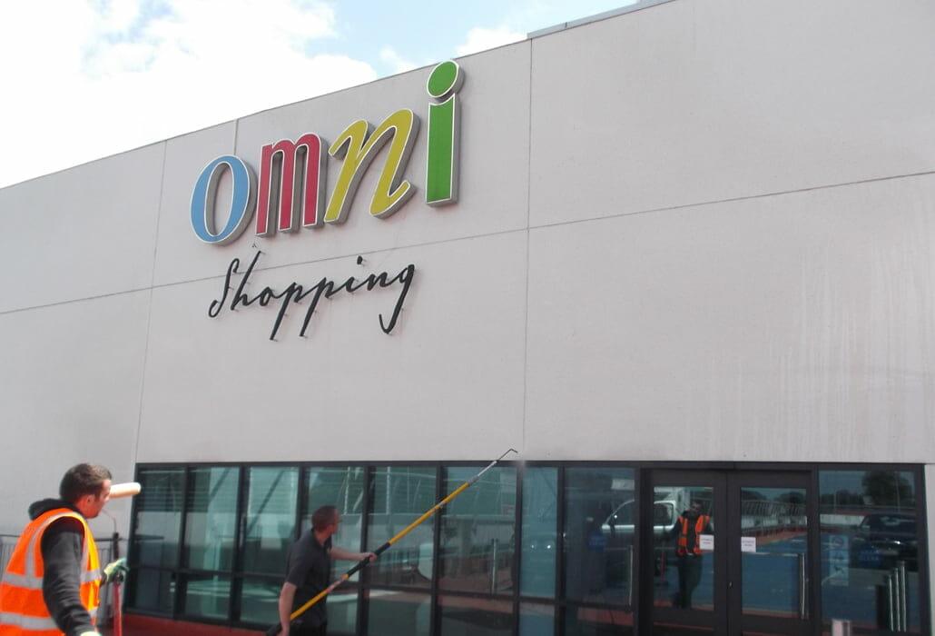 Cleaning a techcrete panel facade - Omni shopping centre