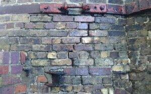 Powers' whiskey stills restoration project badly damaged brickwork