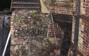 Powers' whiskey stills restoration project badly damaged brickwork and graffiti