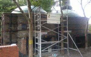 Powers' whiskey stills restoration project removing vegetation