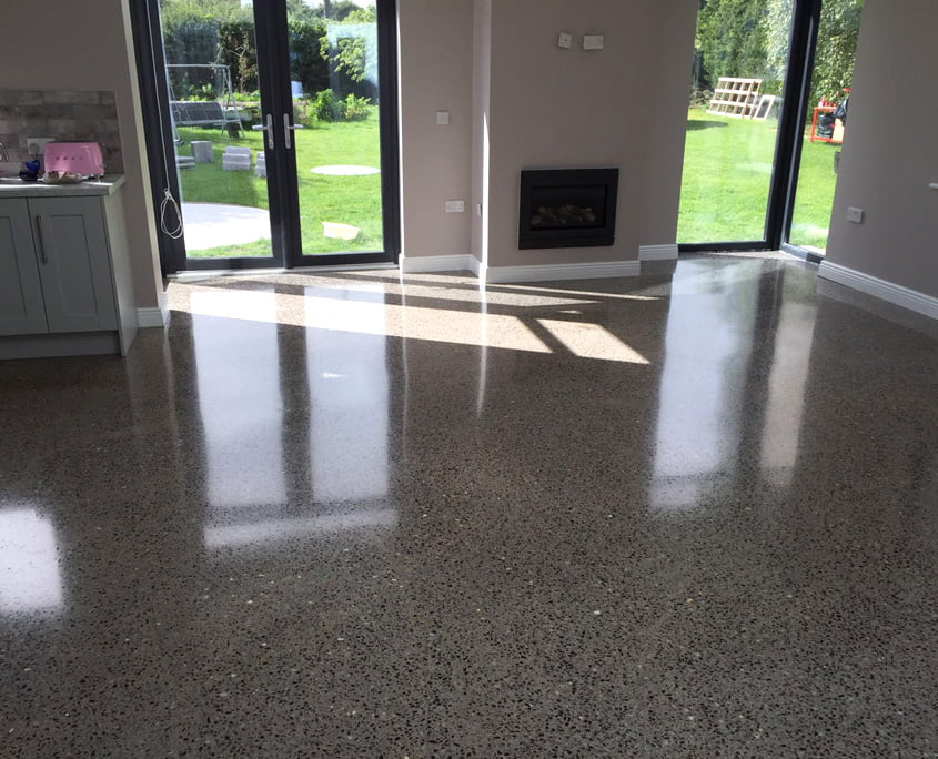 Platinum finish polished concrete with a topical seal | P Mac