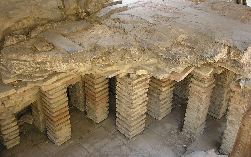 Hypocaust system early underfloor heating Arles Thermes de Constantin France