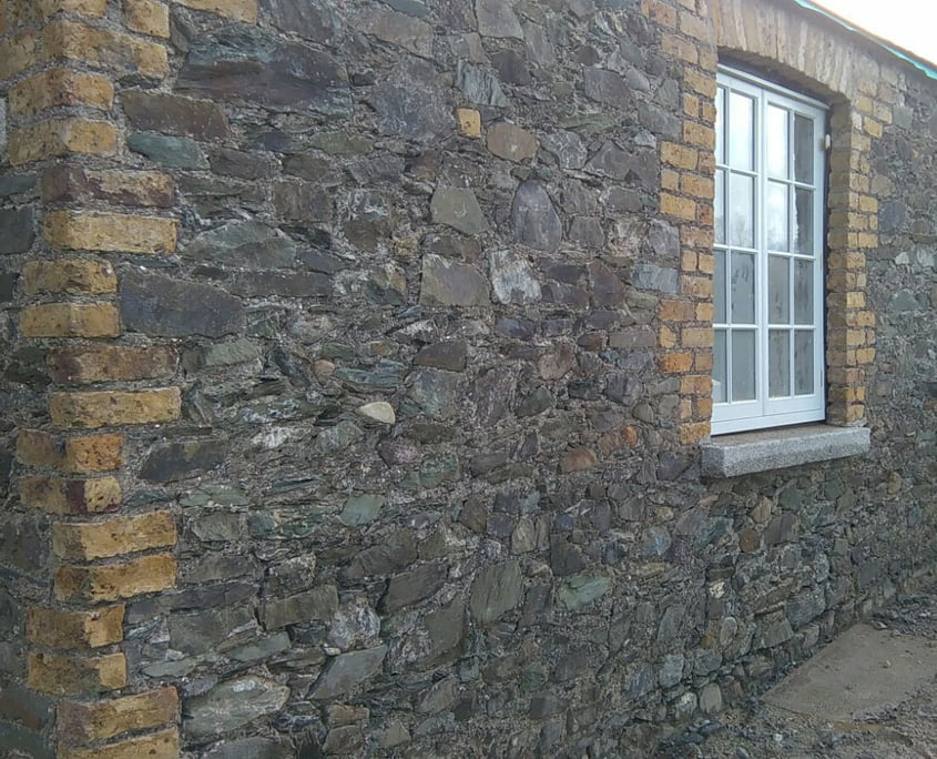 Limestone and brick exposed on cottage at Gilltown Stud