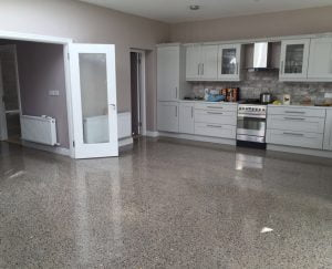 Polished concrete floor to platinum finish and coated with a topical seal