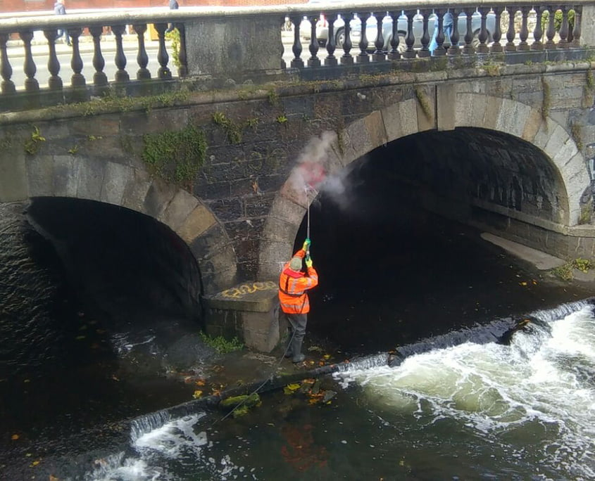 Removing graffiti from Drumcondra Bridge