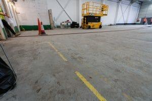 Warehouse floor before grinding